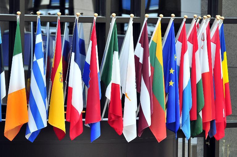 Flags of the members of the European Council hang outside the EU headquarters on May 21, 2014 in Brussels
