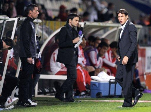 Lille's coach Rudi Garcia (R) is pictured during the friendly football match Lille vs Benfica on July 16