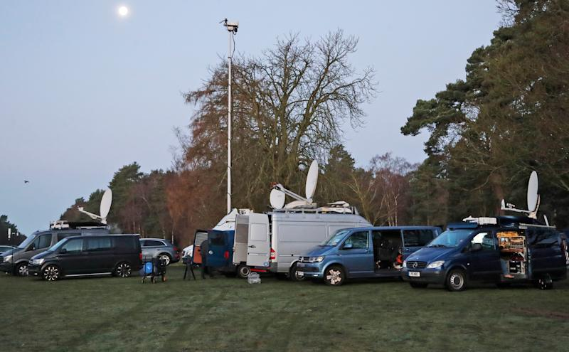Media trucks gather at the entrance of Sandringham on Jan. 13 before a royal summit to discuss Prince Harry and Duchess Meghan's desire to reduce their roles in the royal family.