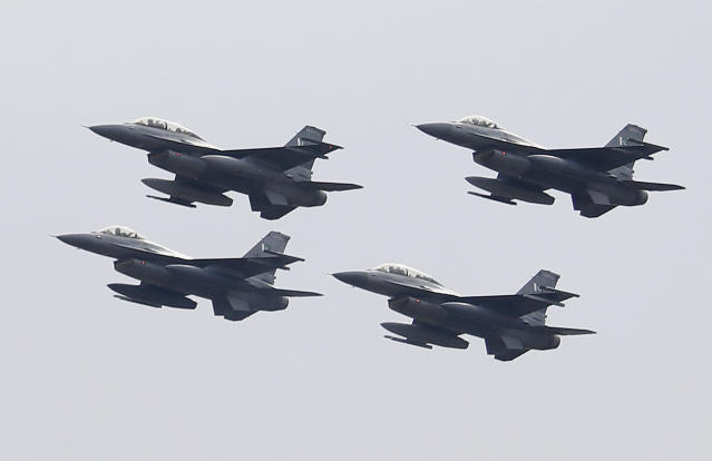 Pakistani Air Force F-16 fighter jets fly in formation during a military parade to mark Pakistan National Day, in Islamabad, Pakistan, Saturday, March 23, 2019. Pakistanis are celebrating their National Day with a military parade that's showcasing short- and long-range missiles, tanks, jets, drones and other hardware. (AP Photo/Anjum Naveed)