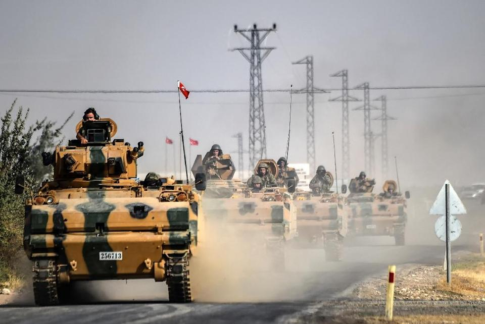 Turkey says its unprecedented operation on the Syrian border aims to rid the area of both the Islamic State group and anti-IS Kurdish YPG militia (AFP Photo/Bulent Kilic)