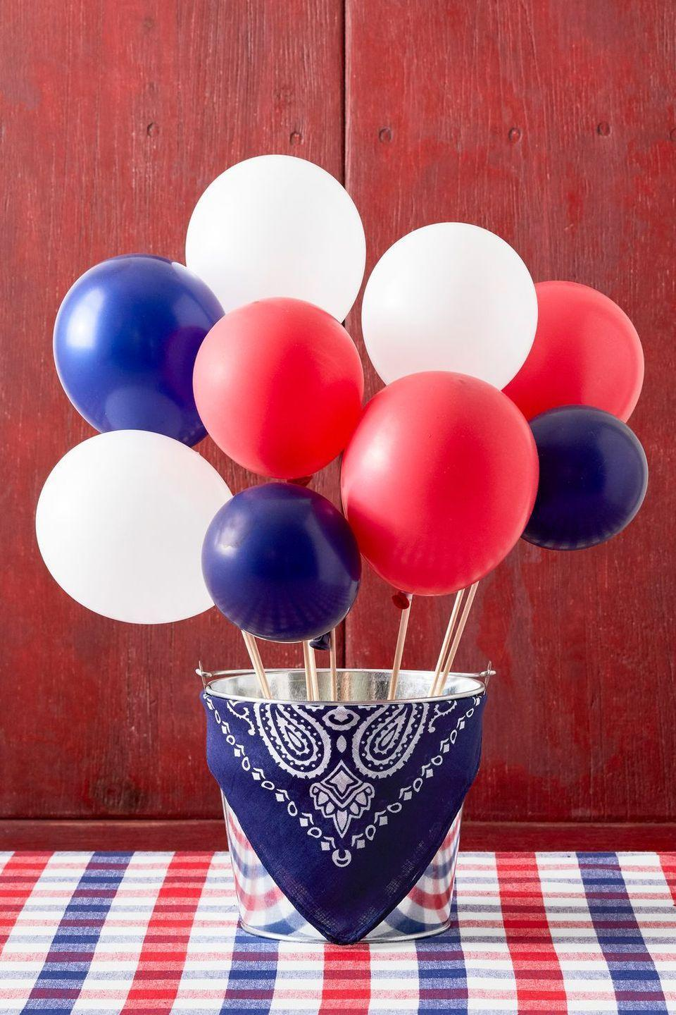 """<p>Yes, having balloons at your party is nice, but a balloon <em>centerpiece </em>is next-level. Affix balloons to wooden dowels, then place them in a bucket full of sand. </p><p><a class=""""link rapid-noclick-resp"""" href=""""https://go.redirectingat.com?id=74968X1596630&url=https%3A%2F%2Fwww.walmart.com%2Fsearch%2F%3Fquery%3Dwooden%2Bdowels&sref=https%3A%2F%2Fwww.thepioneerwoman.com%2Fjust-for-fun%2Fg36599700%2Fsummer-party-ideas%2F"""" rel=""""nofollow noopener"""" target=""""_blank"""" data-ylk=""""slk:SHOP WOODEN DOWELS"""">SHOP WOODEN DOWELS</a></p>"""