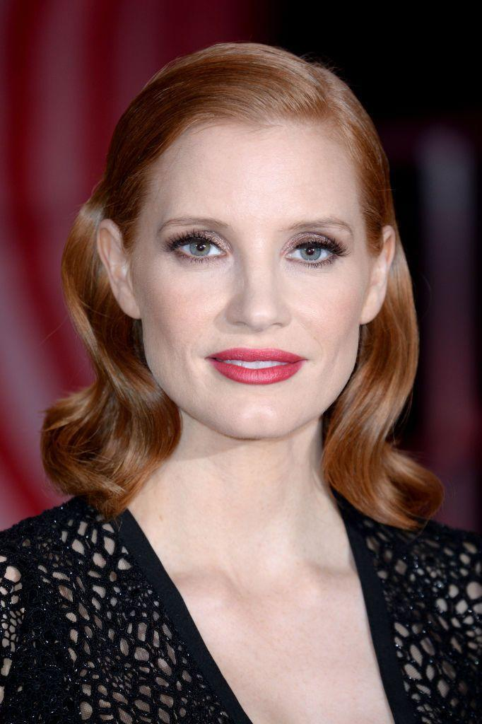 <p>If you're a redhead like Jessica Chastain (and Ree), pink lipstick really pops. The combo of this vibrant shade with gray metallic eyeshadow is just beautiful. </p>