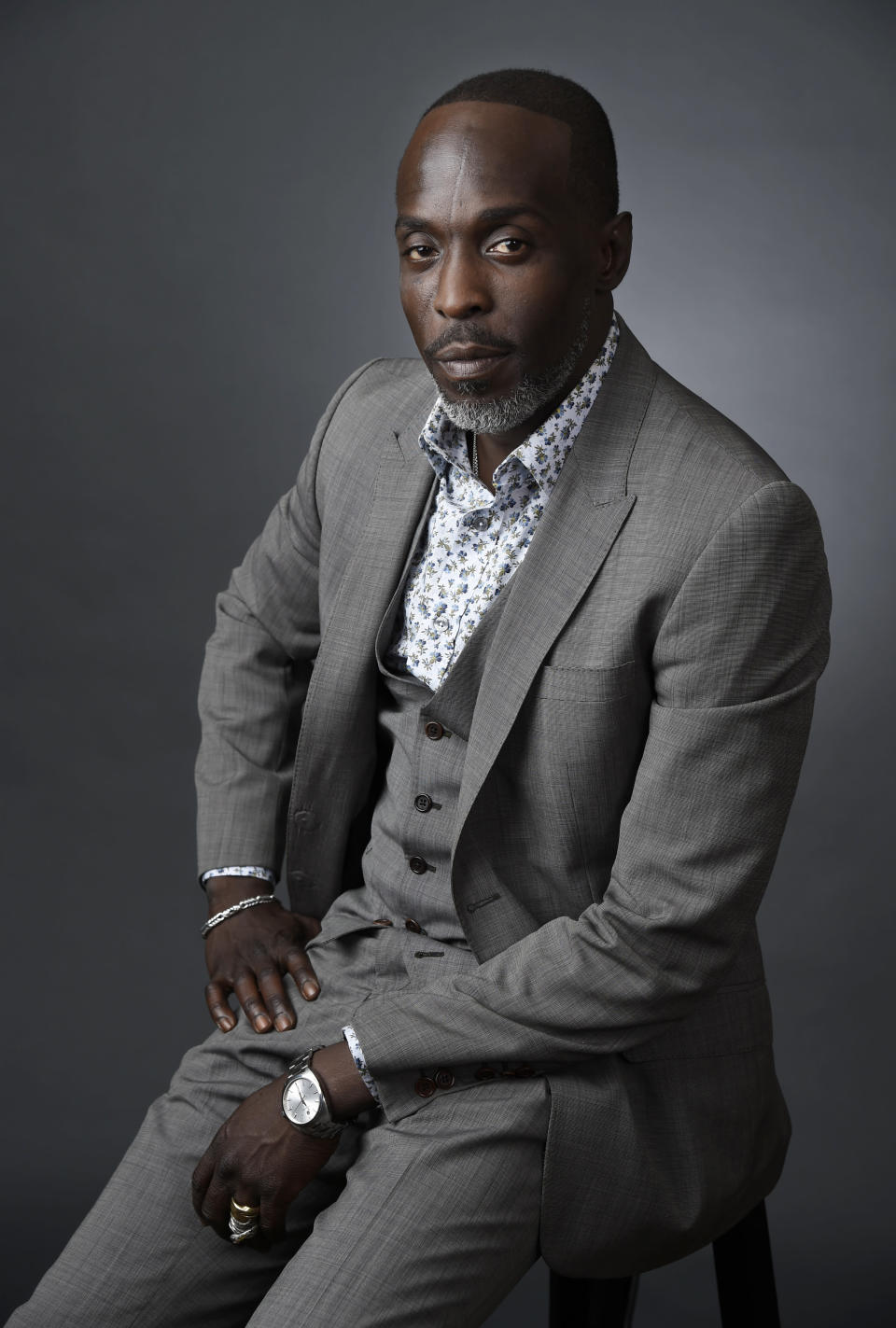 """FILE - In this Saturday, July 30, 2016, file photo, Michael Kenneth Williams, a cast member in the HBO series """"The Night Of,"""" poses for a portrait during the 2016 Television Critics Association Summer Press Tour at the Beverly Hilton in Beverly Hills, Calif. Williams, who played the beloved character Omar Little on """"The Wire,"""" has died. New York City police say Williams was found dead Monday, Sept. 6, 2021, at his apartment in Brooklyn. He was 54. (Photo by Chris Pizzello/Invision/AP, File)"""