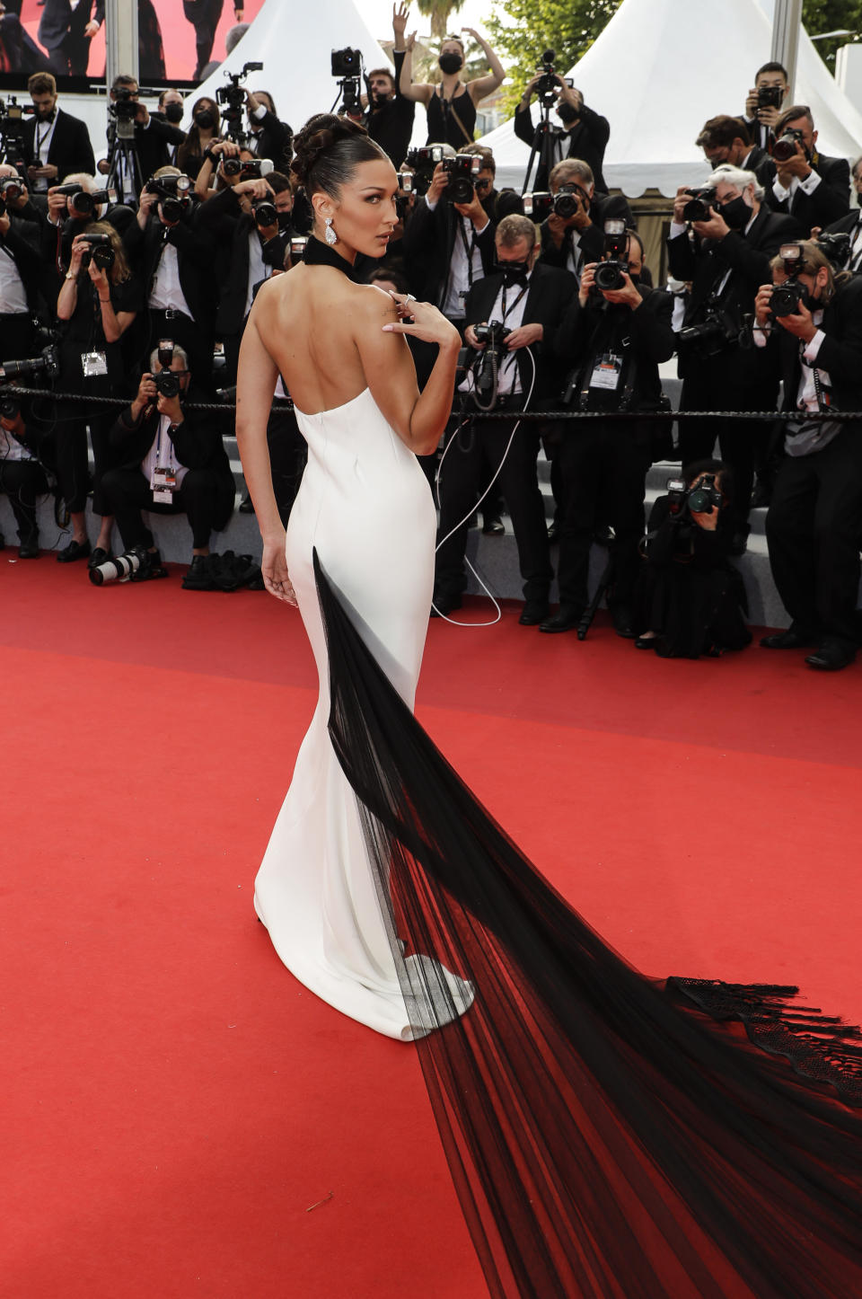 Bella Hadid poses for photographers upon arrival at the premiere of the film 'Annette' and the opening ceremony of the 74th international film festival, Cannes, southern France, Tuesday, July 6, 2021. (Photo by Vianney Le Caer/Invision/AP)