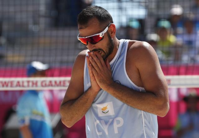 Beach Volleyball - Gold Coast 2018 Commonwealth Games - Men Preliminary - Pool C - New Zealand v Cyprus - Coolangatta Beachfront - Gold Coast, Australia - April 6, 2018. Georgios Chrysostomou of Cyprus reacts. REUTERS/Paul Childs