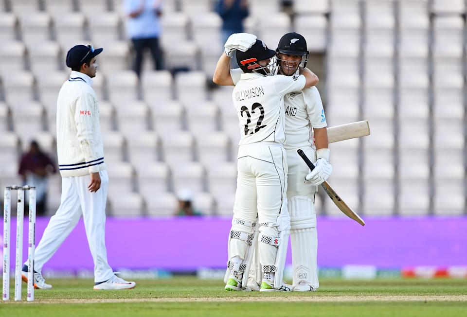 SOUTHAMPTON, ENGLAND - JUNE 23: Kane Williamson and Ross Taylor of New Zealand celebrate victory after the Reserve Day of the ICC World Test Championship Final between India and New Zealand at The Hampshire Bowl on June 23, 2021 in Southampton, England. (Photo by Alex Davidson/Getty Images)