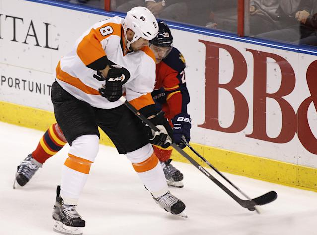 Philadelphia Flyers defenseman Nicklas Grossmann (8) and Florida Panthers left wing Sean Bergenheim (20) fight for the puck during the second period of an NHL hockey game in Sunrise, Fla., on Tuesday, April 8, 2014. (AP Photo/Terry Renna)