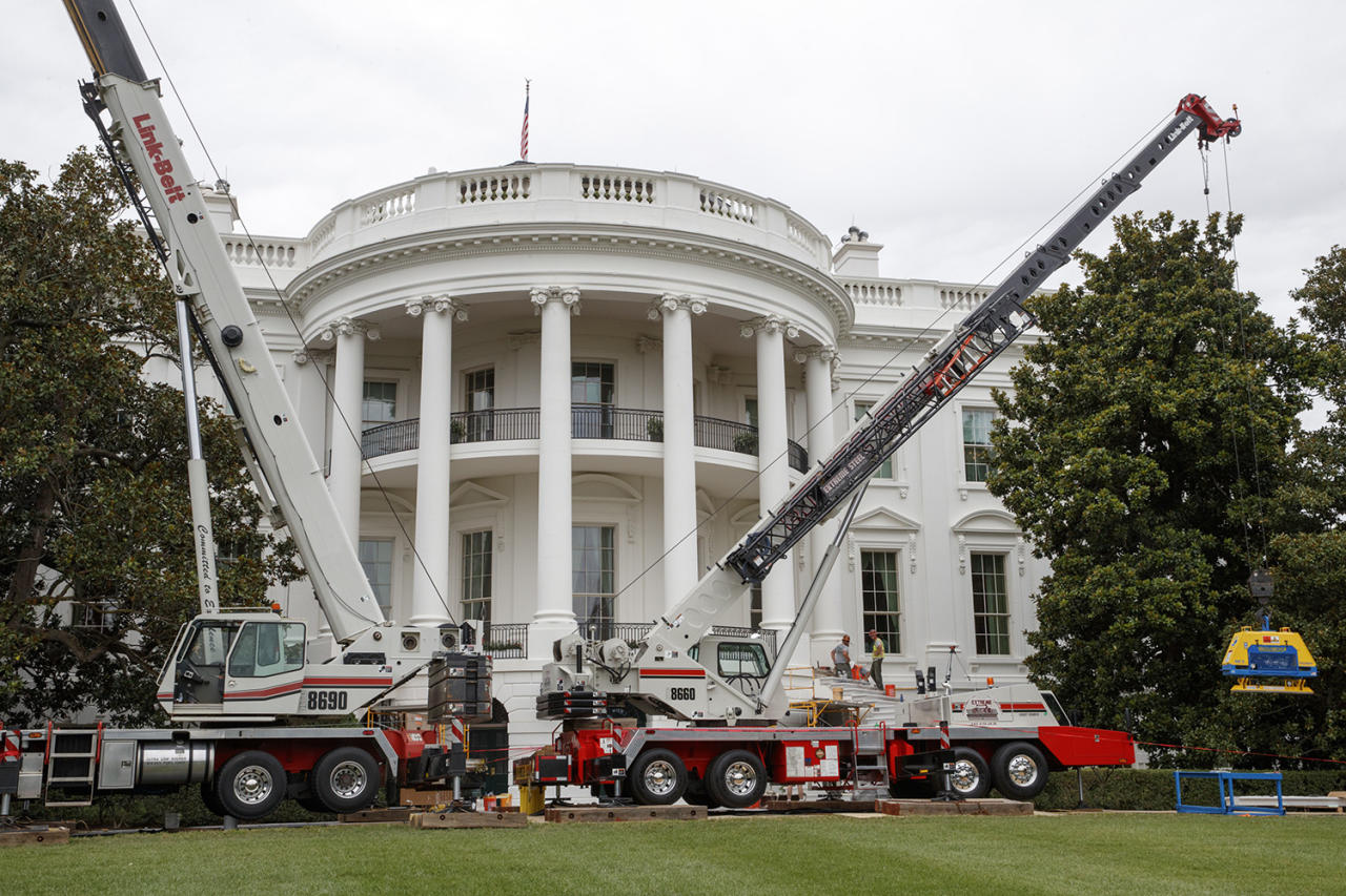 <p>Cranes are positioned in front of the South Portico of the White House in Washington, Friday, Aug. 11, 2017, during renovations while President Donald Trump is spending time at his golf resort in New Jersey. (AP Photo/J. Scott Applewhite) </p>