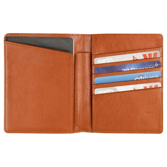 "This wallet holds two passports, cash, cards, boarding pass, and a pen. It's a sleek way to keep all of your travel essentials within arms length. <strong><a href=""https://www.ahalife.com/product/149000040621/leather-passport-holder"" rel=""nofollow noopener"" target=""_blank"" data-ylk=""slk:Get it here"" class=""link rapid-noclick-resp"">Get it here</a></strong>."