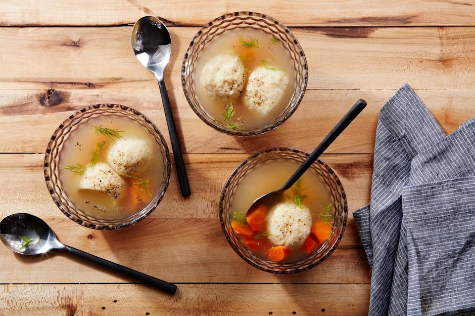 """Chicken soup is traditional with matzo balls, but the richer flavor of turkey broth manages to make the recipe even more comforting. <a href=""""https://www.epicurious.com/recipes/food/views/turkey-matzo-ball-soup?mbid=synd_yahoo_rss"""" rel=""""nofollow noopener"""" target=""""_blank"""" data-ylk=""""slk:See recipe."""" class=""""link rapid-noclick-resp"""">See recipe.</a>"""
