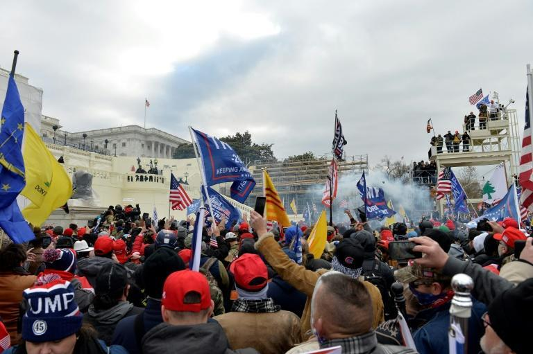 """Trump supporters' storming of the US Capitol dominated international front pages, with many blaming the president for the """"chaos"""" that ensued"""