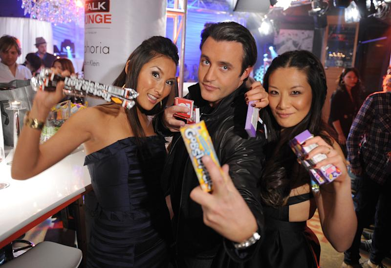 Ben Mulroney and Elaine Lui, right, with fellow eTalk host Tanya Kim at the 2008 Juno Awards in Calgary on April 6, 2008. (Photo: George Pimentel via Getty Images)