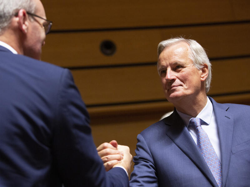 European Union chief Brexit negotiator Michel Barnier, right, shakes hands with Irish Foreign Minister Simon Coveney during a meeting of EU General Affairs ministers, Article 50, at the European Convention Center in Luxembourg, Tuesday, Oct. 15, 2019. European Union chief Brexit negotiator Michel Barnier is in Luxembourg on Tuesday to brief ministers on the state of play for Brexit. (AP Photo/Virginia Mayo)