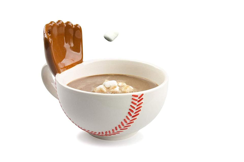 <p>This clever <span>The Mug With A Glove</span> ($25) will catch cereal or marshmallows that you toss its way.</p>