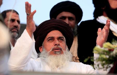 FILE PHOTO: Khadim Hussain Rizvi, leader of the Tehreek-e-Labaik Pakistan an Islamist political party, leads members in shouting slogans during a sit-in in Rawalpindi