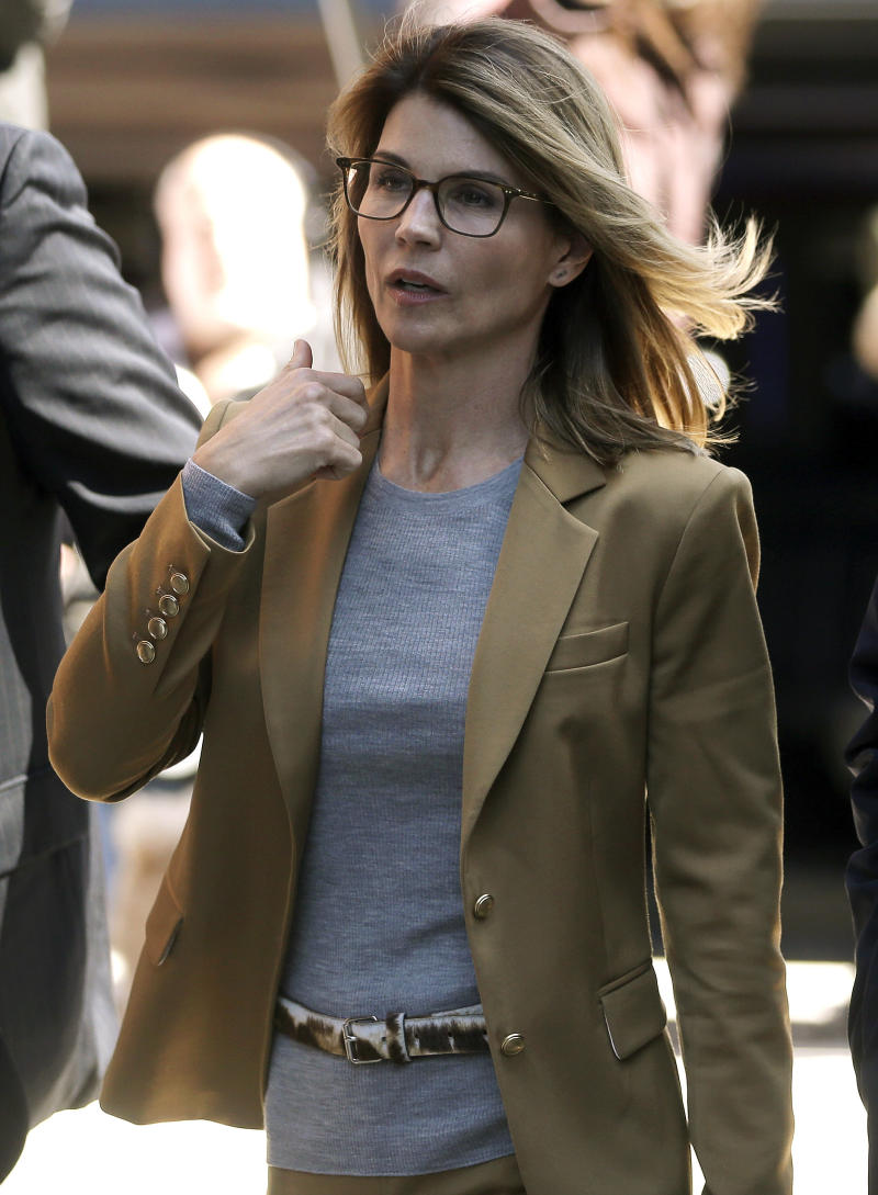 Lori Loughlin arrives at federal court in Boston on Wednesday, April 3, 2019, to face charges in a nationwide college admissions bribery scandal. | Steven Senne—AP