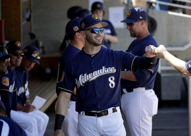 """<a class=""""link rapid-noclick-resp"""" href=""""/mlb/players/8034/"""" data-ylk=""""slk:Ryan Braun"""">Ryan Braun</a> bumping fists before his first spring training game of the season on March 10, 2017. (AP Photo)"""