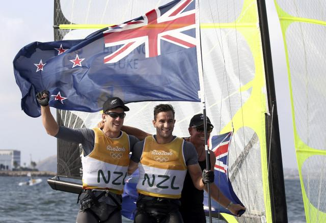 2016 Rio Olympics - Sailing - Final - Men's Skiff - 49er - Medal Race - Marina de Gloria - Rio de Janeiro, Brazil - 18/08/2016. Peter Burling (NZL) of New Zealand and Blair Tuke (NZL) of New Zealand celebrate winning gold medal. REUTERS/Benoit Tessier FOR EDITORIAL USE ONLY. NOT FOR SALE FOR MARKETING OR ADVERTISING CAMPAIGNS.