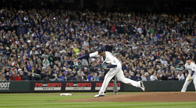Seattle Mariners starting pitcher Felix Hernandez throws the first pitch to the Cleveland Indians in the first inning of a baseball game Thursday, March 29, 2018, in Seattle. (AP Photo/Elaine Thompson)
