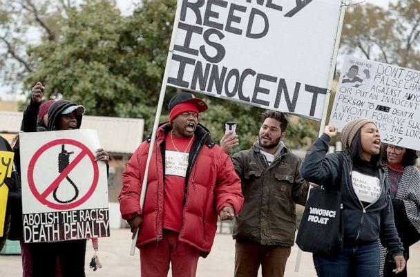 PHOTO: People chant along a street during a protest against the execution of Rodney Reed on Wednesday, Nov. 13, 2019, in Bastrop, Texas. (Nick Wagner/Austin American-Statesman via AP)