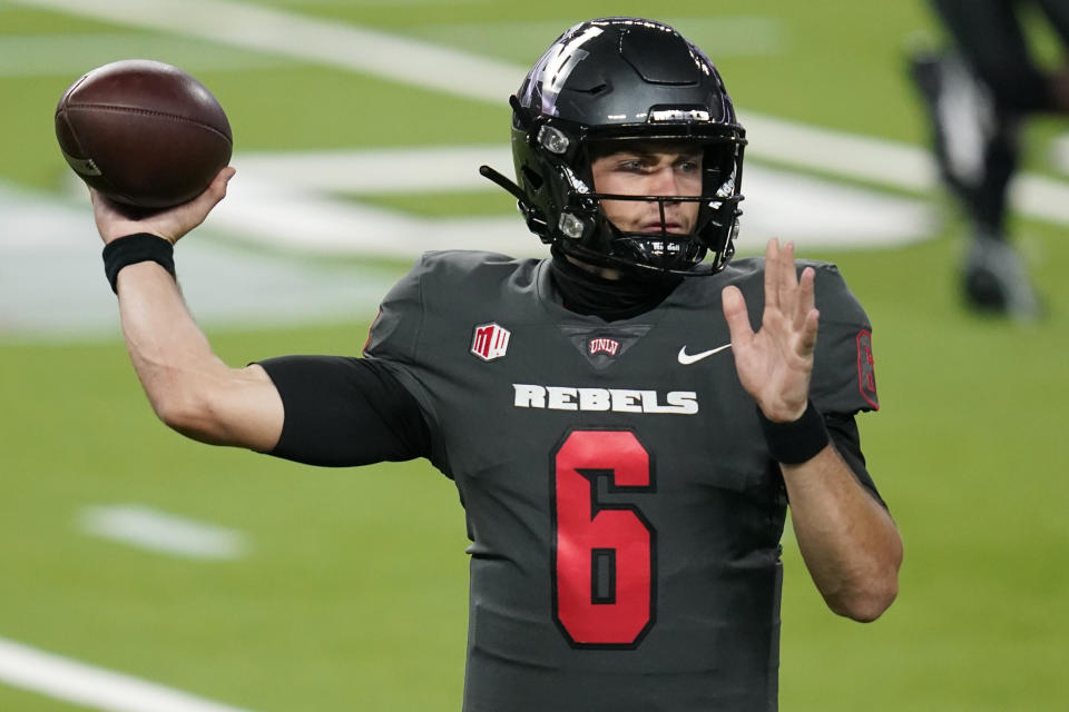 UNLV quarterback Max Gilliam throws a pass during the first half of the team's NCAA college football game against Nevada on Saturday, Oct. 31, 2020, in Las Vegas. (AP Photo/John Locher)