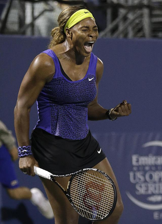 Serena Williams celebrates after beating Ana Ivanovic, from Serbia, during their match in the Bank of the West Classic tennis tournament in Stanford, Calif., Friday, Aug. 1, 2014. Williams won 2-6, 6-3, 7-5. (AP Photo/Jeff Chiu)