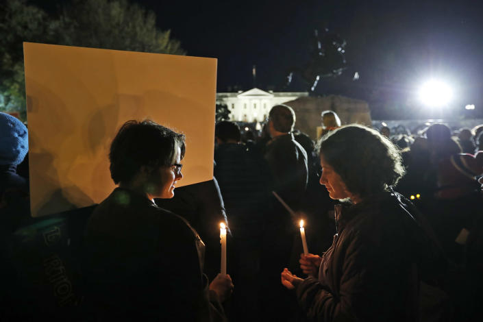 <p>Elizabeth O'Brien, left, from Washington, and Hannah Allan, from New York, hold candles during an election protest in Lafayette Square Park in front of the White House, Saturday, Nov. 12, 2016 in Washington. (AP Photo/Alex Brandon) </p>