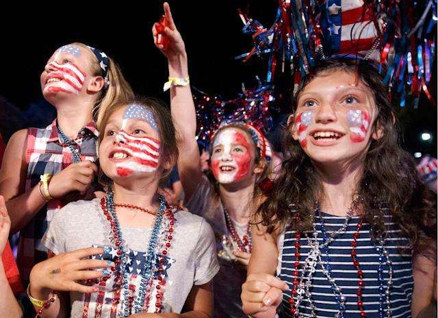 <p>Children sing along during a rehearsal for the annual Boston Pops Fireworks Spectacular on the Esplanade, Monday, July 3, 2017, in Boston, Mass. (Photo: Michael Dwyer/AP) </p>