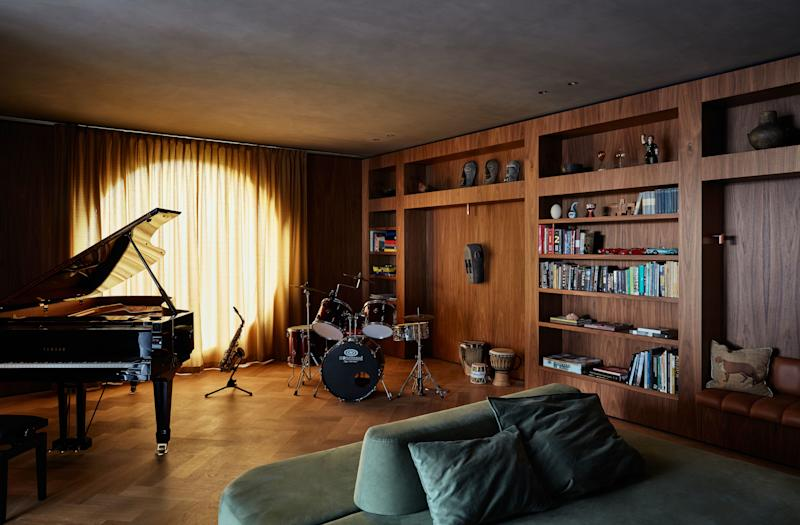 The walls and floor of the music room are lined in walnut and oak. The ceiling is dark stucco, creating an intimate and acoustically ideal room. As all the kids love to play instruments, this is the room where most of the action occurs on the weekends.