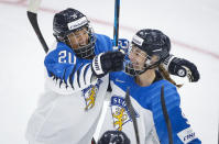 Finland's Nelli Laitinen, right, celebrates her goal with teammate Matilda Nilsson during the first period of an IIHF women's hockey championship game against Canada in Calgary, Alberta, Friday, Aug. 20, 2021. (Jeff McIntosh/The Canadian Press via AP)