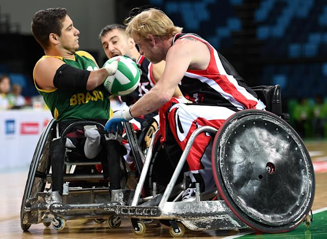 RIO DE JANEIRO, BRAZIL - FEBRUARY 26: Julio Cesar Braz of Brazil competes against Patrice Simard (C) and Garret Deane Hickling of Canada during the International Wheelchair Rugby Championship - Aquece Rio Test Event for the Rio 2016 Paralympics match between Brazil and Canada at Olympic Park on February 26, 2016 in Rio de Janeiro, Brazil. (Photo by Buda Mendes/Getty Images)