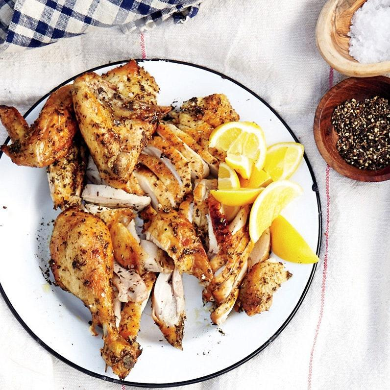 """Rub a whole chicken with garlic and herbes de Provence (an aromatic mix of dried herbs including lavender, thyme, and oregano) before roasting until golden. Serve with lemon wedges. <a href=""""https://www.epicurious.com/recipes/food/views/roast-provencal-chicken-51169070?mbid=synd_yahoo_rss"""" rel=""""nofollow noopener"""" target=""""_blank"""" data-ylk=""""slk:See recipe."""" class=""""link rapid-noclick-resp"""">See recipe.</a>"""