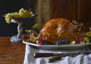 """<p>This traditional Thanksgiving turkey is roasted with a New England stuffing with chopped apples and fragrant herbs that naturally soaks up all the drippings. To ensure the bird cooks evenly and moist, the recipe has you cover the bird in a cheesecloth that's been saturated in butter while it roasts in the oven. <a href=""""https://www.yahoo.com/food/traditional-roast-turkey-with-apple-sage-dressing-183213532.html"""" data-ylk=""""slk:Get the Traditional Roast Turkey with Apple-Sage Dressing recipe;outcm:mb_qualified_link;_E:mb_qualified_link;ct:story;"""" class=""""link rapid-noclick-resp yahoo-link""""><b>Get the Traditional Roast Turkey with Apple-Sage Dressing recipe</b></a>. (<i>Photo: <i>Matthew Benson)</i></i></p>"""