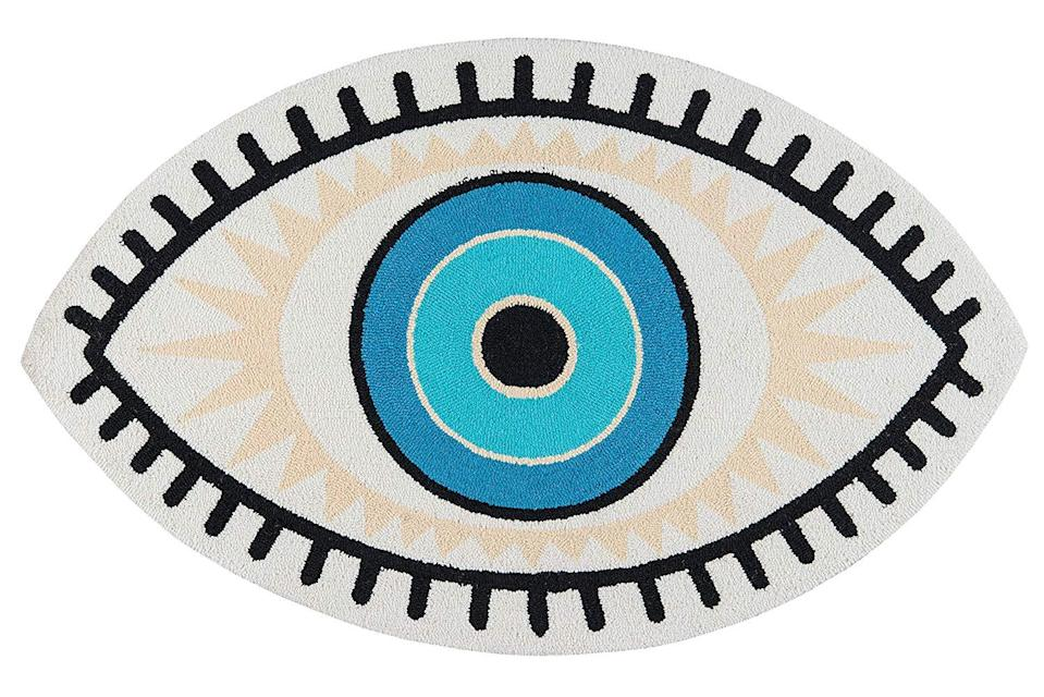 "<br> <br> <strong>Novogratz Collection</strong> All Seeing Eye Area Rug (2' X 3'), $, available at <a href=""https://www.amazon.com/Novogratz-Momeni-CUCINCNA-9MTI2030-Cucina-Kitchen/dp/B07P9SFDZN"" rel=""nofollow noopener"" target=""_blank"" data-ylk=""slk:Amazon"" class=""link rapid-noclick-resp"">Amazon</a>"