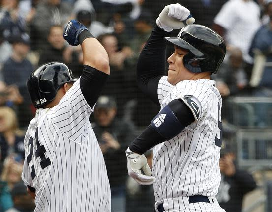 Gary Sanchez (left) and Aaron Judge celebrate Judge's first homer of 2018. Together with Giancarlo Stanton, the Yankees power trio homered in the same game for the first time in a 7-2 win against the Rays. (AP)
