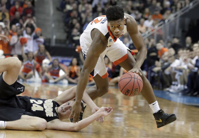 FILE - In this March 30, 2019, file photo, Virginia's De'Andre Hunter dribbles past Purdue's Grady Eifert (24) during the first half of a men's NCAA Tournament college basketball South Regional final game, in Louisville, Ky. Hunter is a high prospect in the NBA Draft on Thursday, June 20. (AP Photo/Michael Conroy, File)