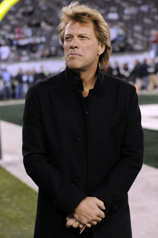 Musical artist Jon Bon Jovi looks on before an an NFL football game between the New York Jets and the New England Patriots Sunday, Nov. 13, 2011 in East Rutherford, N.J. (AP Photo/Bill Kostroun)