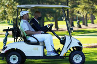 Bryson DeChambeau gets a ride back to the third tee box to hit again after his ball was lost during the second round of the Masters golf tournament Friday, Nov. 13, 2020, in Augusta, Ga. (AP Photo/David J. Phillip)