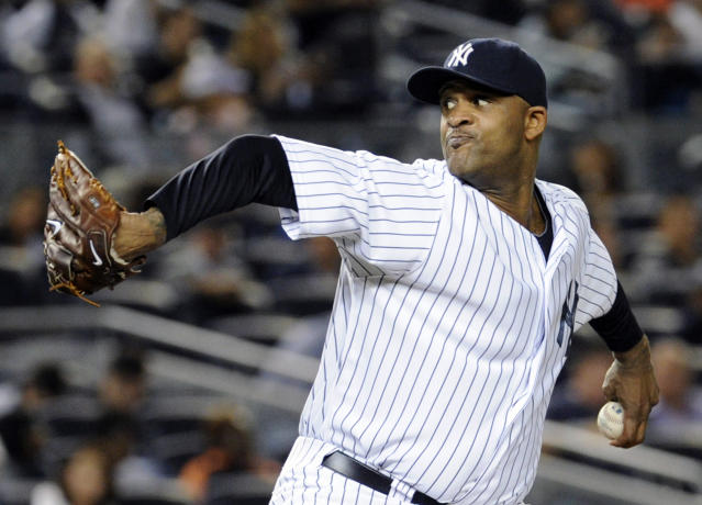 New York Yankees pitcher CC Sabathia delivers the ball during the second inning of an interleague baseball game against the San Francisco Giants, Friday, Sept. 20, 2013, at Yankee Stadium in New York. (AP Photo/Bill Kostroun)