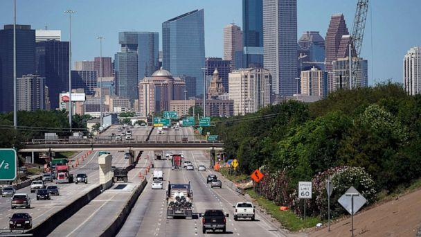 PHOTO: Traffic moves along Interstate 10, April 30, 2020, near downtown Houston during the coronavirus pandemic which shut down much of Houston's economic activity. (David J. Phillip/AP, FILE)