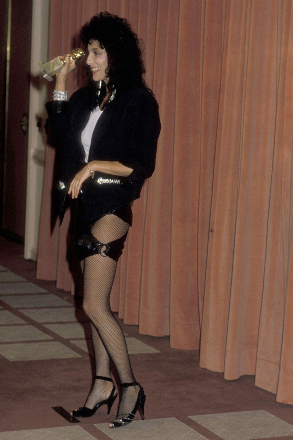 <p>A tight mini with a large cut-out was far from Cher's usual glamorous meets theatrical outfits at the 1984 ceremony.</p>