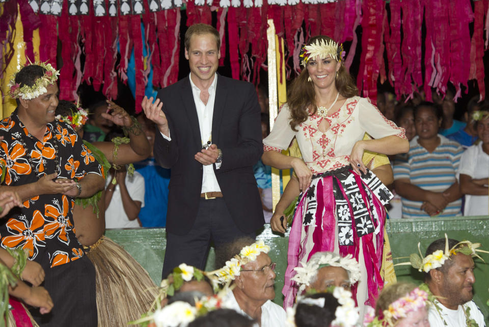 TUVALU - SEPTEMBER 18: Prince William, Duke of Cambridge and Catherine, Duchess of Cambridge dance with the ladies at the Vaiku Falekaupule for an entertainment programme on September 18, 2012 in Tuvalu. Prince William, Duke of Cambridge and Catherine, Duchess of Cambridge are on a Diamond Jubilee tour representing the Queen taking in Singapore, Malaysia, the Solomon Islands and Tuvalu.  (Photo by Arthur Edwards - Pool/Getty Images)