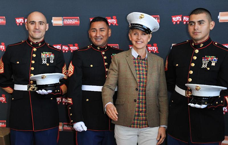"From left, Gunnery Sergeant Phillip Campo, Staff Sergeant Victor Pozo, Ellen DeGeneres, Sergeant Antonio Sanchezattend the Ellen DeGeneres officially launches the Duracell ""Power a Smile"" Program, on Friday, Nov. 22, 2013, at Van Nuys Airport in Los Angeles. (Photo by Richard Shotwell/Invision/AP)"