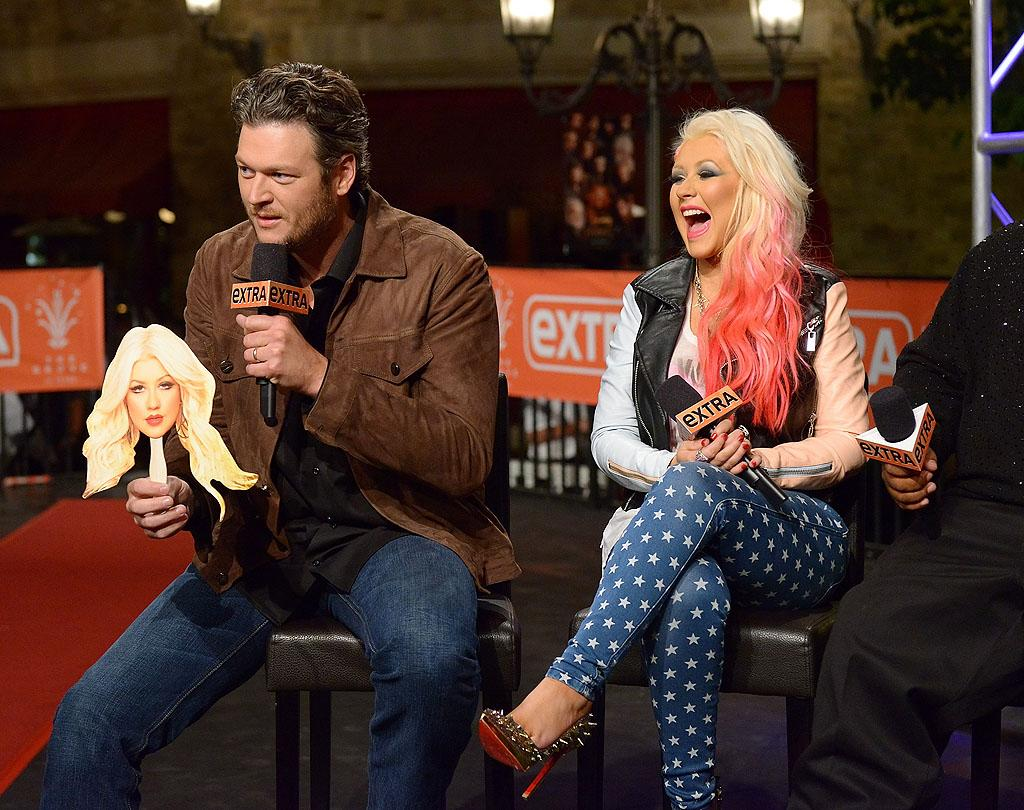 "LOS ANGELES, CA - NOVEMBER 05:  Christina Aguilera (R) and Blake Shelton of ""The Voice"" visit ""Extra"" at The Grove on November 5, 2012 in Los Angeles, California.  (Photo by Noel Vasquez/Getty Images for Extra)"