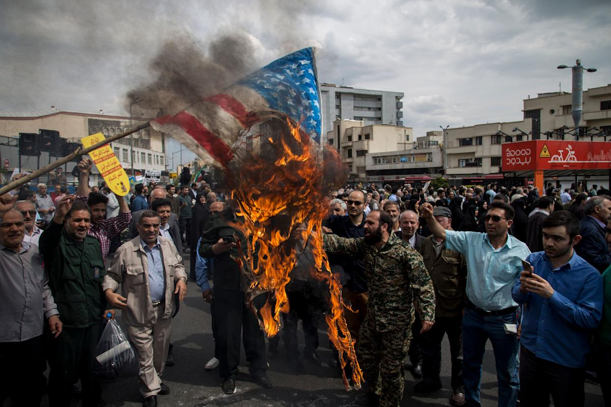 Iranians set ablaze a US flag during an anti-US rally following Friday prayers in Tehran on April 12 2019. The US government on 08 April 2019 said it had designated Iran's revolutionary guard corps (IRGC) as a terrorist organization, marking the first time a US government has made such a designation on a foreign government's organization. (Photo: Rouzbeh Fouladi/NurPhoto via Getty Images)