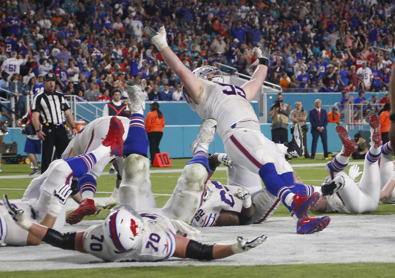 Bills defensive tackle Kyle Williams (95) and his teammates fall to the ground in celebration after Williams scored a touchdown on Sunday. (AP)
