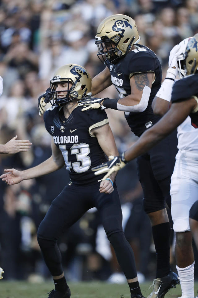 Colorado tight end Legend Brumbaugh, right, jumps on Colorado place kicker Evan Price after he kicked the winning field goal with time expiring in the second half of an NCAA college football game against Stanford, Saturday, Nov. 9, 2019, in Boulder, Colo. Colorado won 16-13. (AP Photo/David Zalubowski)