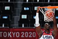 <p>USA's Edrice Femi Adebayo scores a basket in the men's preliminary round group A basketball match between Iran and USA during the Tokyo 2020 Olympic Games at the Saitama Super Arena in Saitama on July 28, 2021. (Photo by Thomas COEX / AFP)</p>