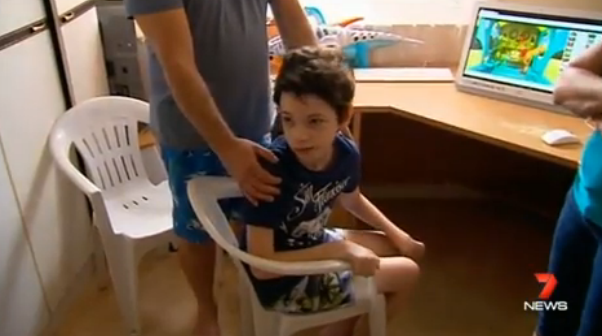 13-year-old Daniel was strapped into a chair at school so he couldn't walk around. Photo: 7 News